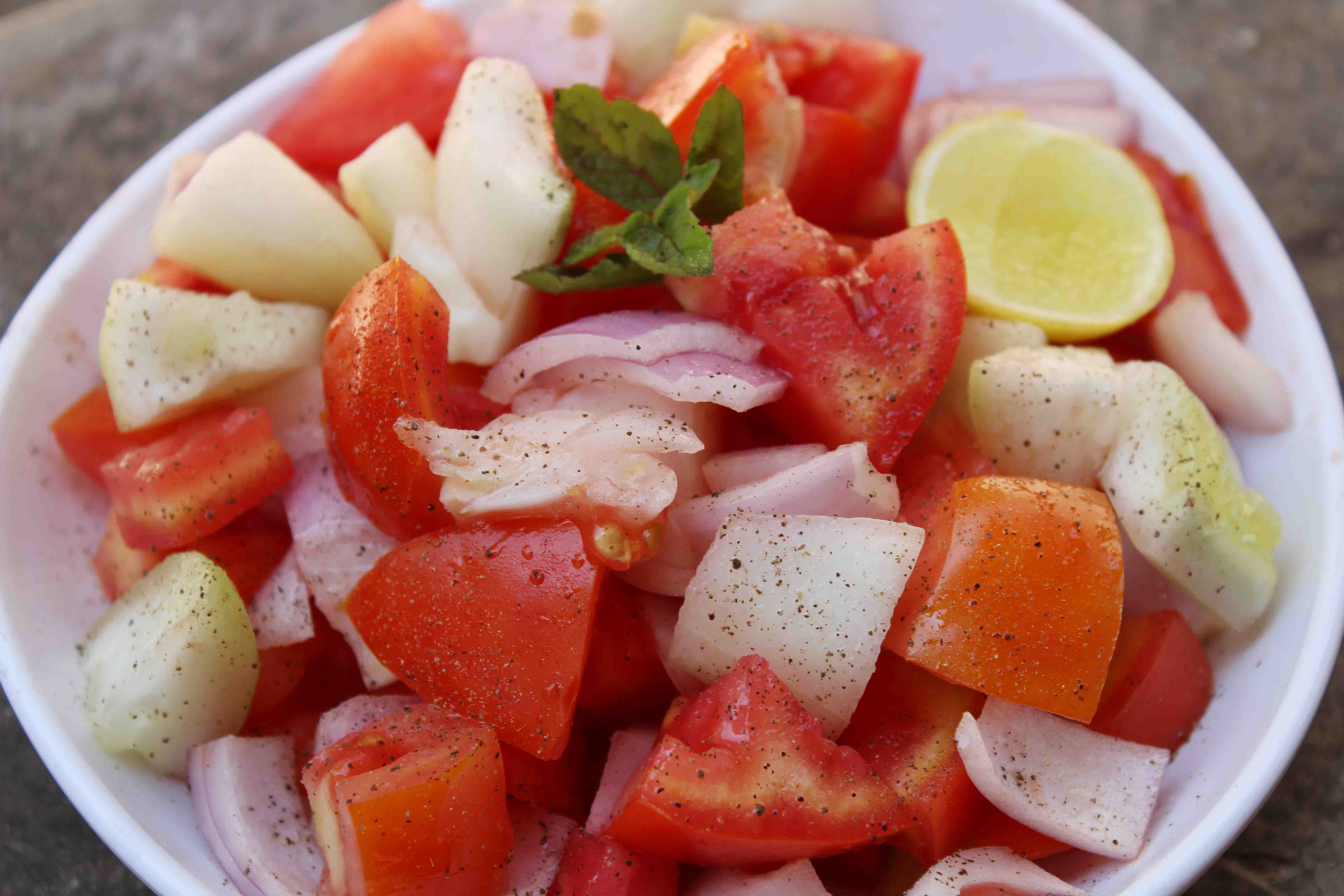 onion, tomato and cucumber salad