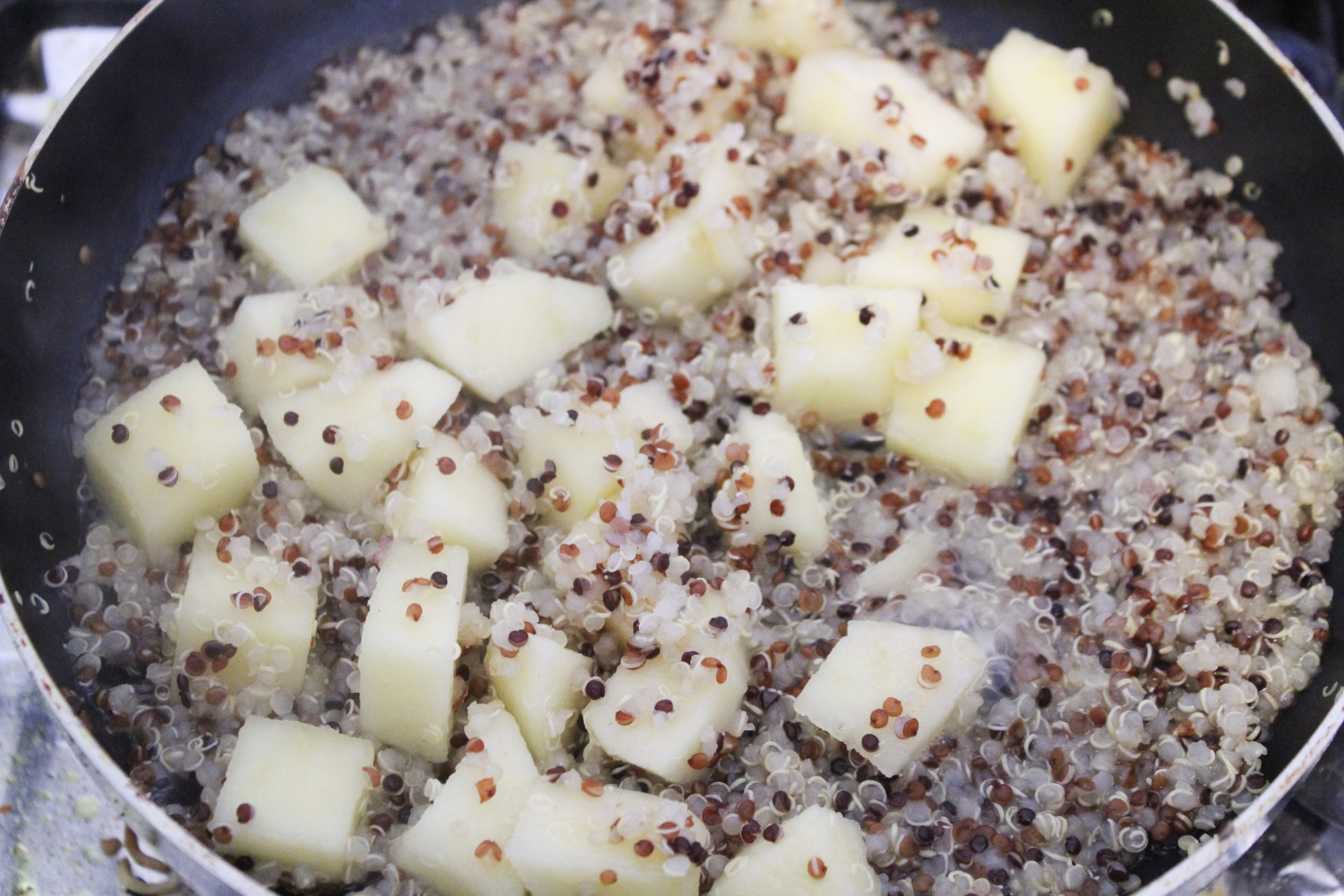 is healthy quinoa breakfast recipe, made with quinoa, apple, cinnamon and milk.